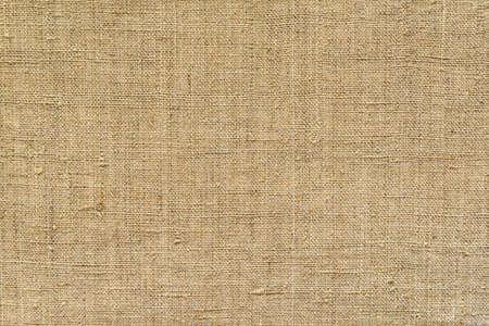 Brown, fabric background from old burlap, horizontal Standard-Bild