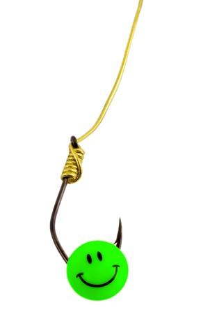 bait on fishing hook , close-up isolated on white background photo