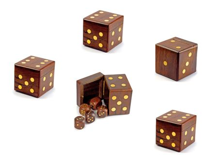 dado: wooden playing dices in dice over white background Stock Photo