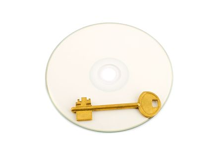 golden key on compact disk photo