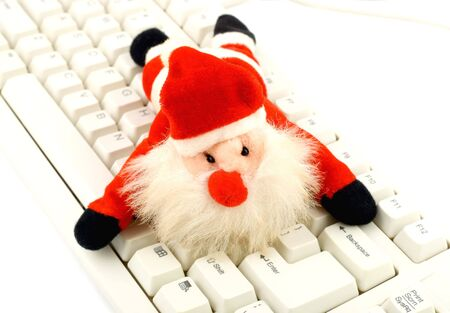 Santa Claus decoration on pc keyboard  photo