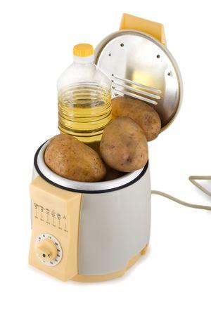fry potatoes prepared in french fries machine photo