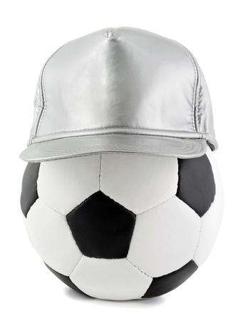soccer ball and baseball cap isolated on the white background photo