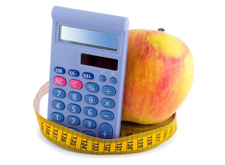 Apple with measuring tape calculator Stock Photo