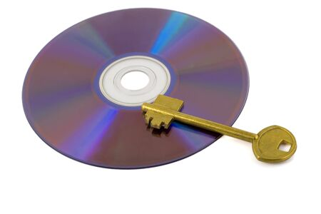 golden key on compact disk isolated on white background Stock Photo - 6251105