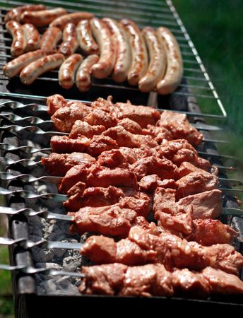 Meat cooking on barbeque grill  photo