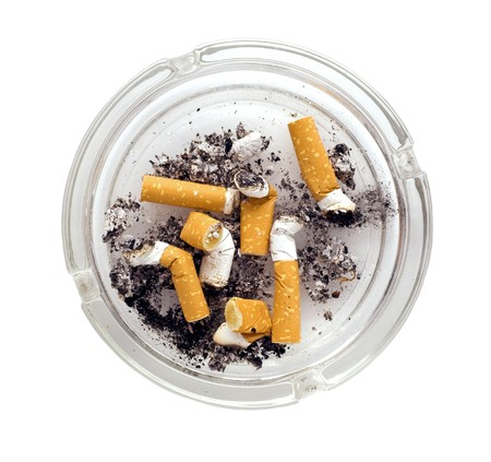 ashtray full of cigarettes close-up isolated on white background