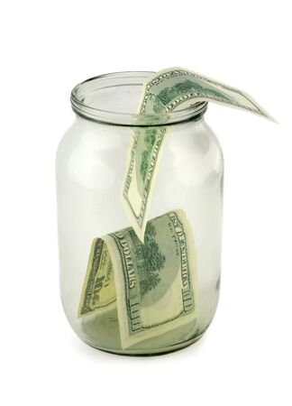 Glass jar of hundreds of dollars isolated  Stock Photo - 8034318