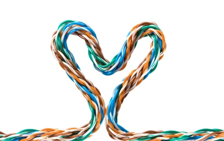 Multicolored computer cable form heart isolated on white background Stock Photo - 8440972