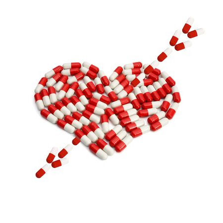Capsules arrow on heart capsule love concepts isolated on white background photo