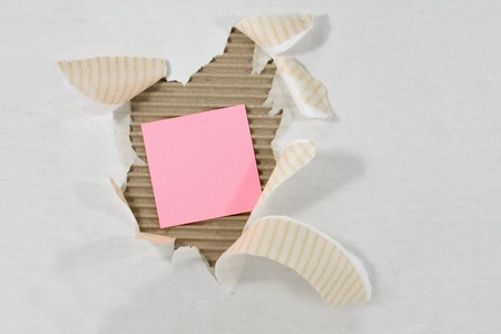 Post-It Note attached Torn Ripped Corrugated Cardboard Stock Photo - 8946361