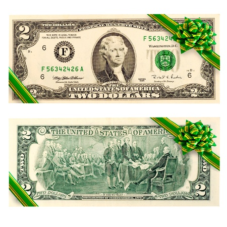 bill payment: two dollar bill gift green ribbon bow  Stock Photo