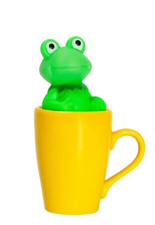 Coffee cup with green frog isolated on white background photo