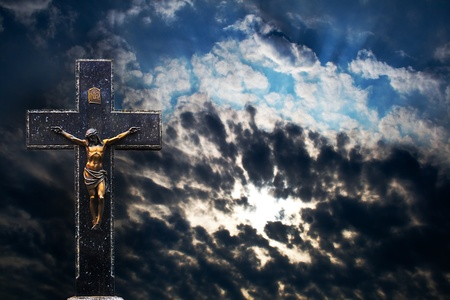Jesus Christ on the Cross at Sunset background photo