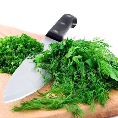 Cutting fresh dill on a cutting board Stock Photo - 12415612