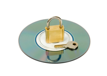 padlock key in CD disc object isolated on white background photo