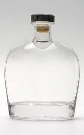 liqueur: bottle glass reflection on gray background