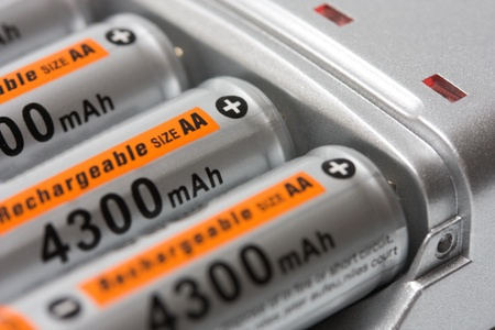 aa: Battery charger with batteries AA background