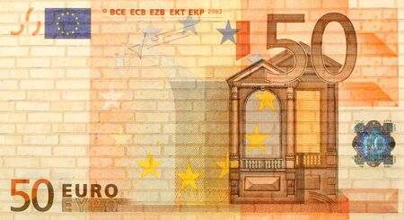 euro money from brick background photo