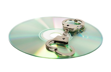 Cd with handcuffs isolated Stock Photo