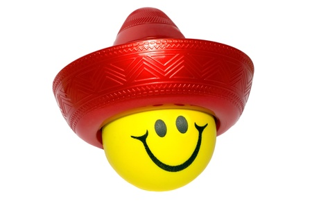 souvenir traditional: happy smileys face in Mexican Sombrero isolated
