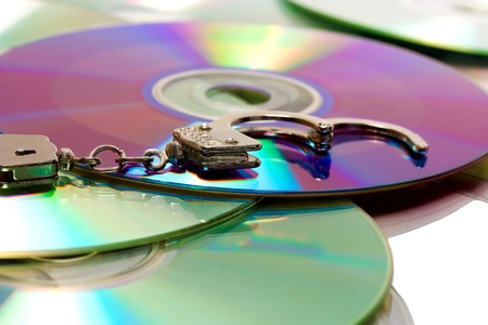 computer software: handcuffs in pile pirate CD