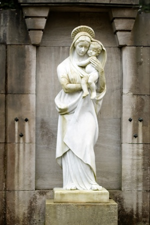 Statue of the virgin Mary carrying the baby Jesus Stock Photo - 12820436