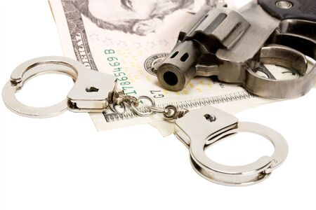Pistol handcuffs money isolated on white photo
