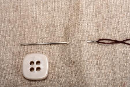 button needle and thread on background fabrics Stock Photo