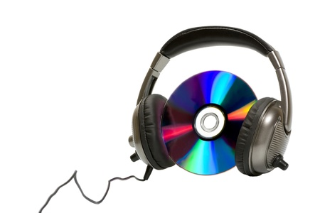 Headphones with CD isolated on white background photo