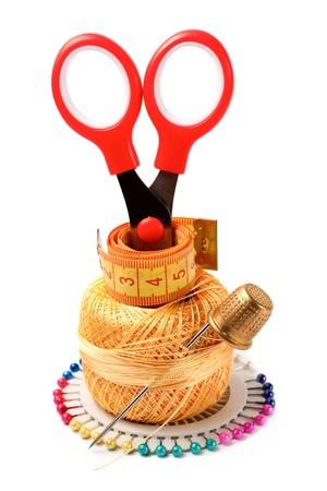 needles, threads, bobbins, scissors, tape measure, thimble isolated on white background