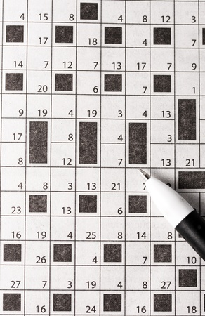 pen in paper, crossword puzzle white background photo