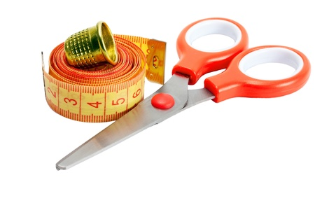 scissors , thimble and measuring tape