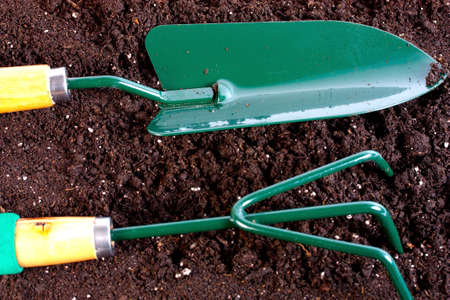 Garden tool with heap of organic compost background Stock Photo - 14000159