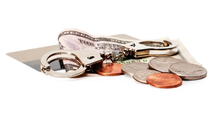 Money and handcuffs of credit card Stock Photo - 14070485