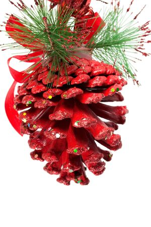 Red christmas pine cone and ribbons on white   photo