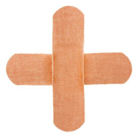 band aid: cross bandagesolated on white background