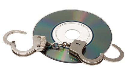 Cd with handcuffs isolated on white background photo