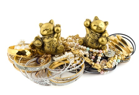 golden lucky cats talismans isolated on white background  photo