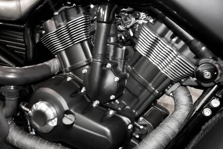 v-twin motorcycle engine close-up detail background