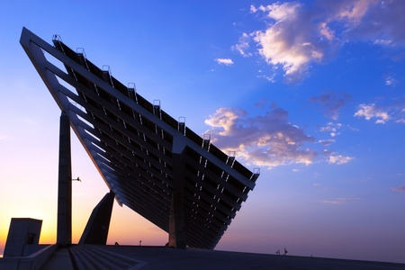 Shining sun and solar panels, Barcelona, Spain photo