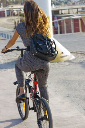 Young girl on a bike crossing in Barcelona Spain photo
