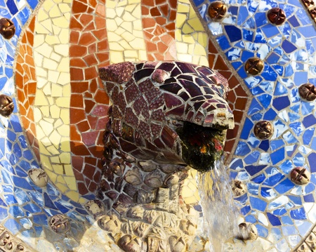 Sculpture of a snake of Antoni Gaudi mosaic in park guell of Barcelona photo