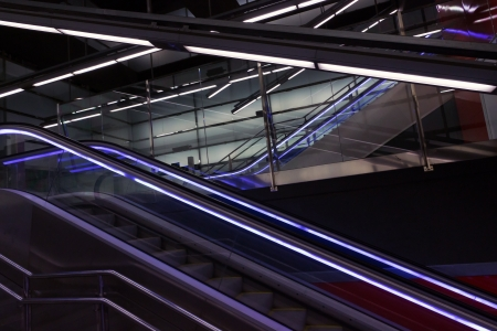Eksalator blue light, stairway - Metro a station Barcelona photo