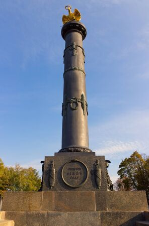 The monument of Glory is an 11&ETH,&frac14, cast-iron column with the bronze parts and the eagle. Poltava. Ukraine photo