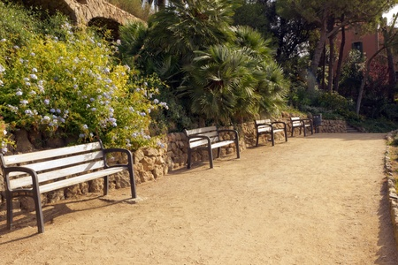 bench on stone gallery in the park Guell in Barcelona - Spain photo