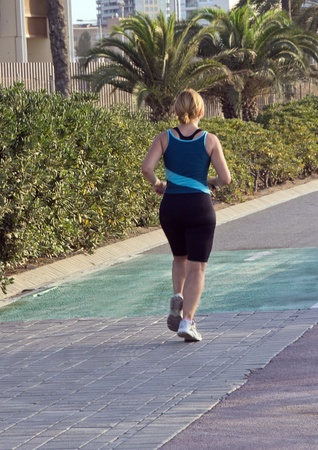 Back view of a girl running Morning jog  photo