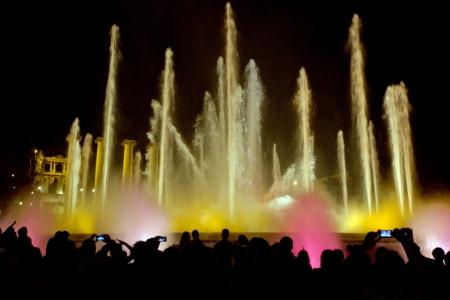 espanya: People Taking picture Magic fountain on Placa De Espanya in Barcelona  Spain