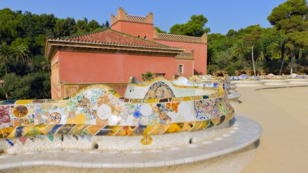 Mosaic snake bench on stone gallery in the park Guell in Barcelona - Spain