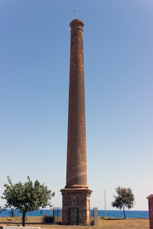 high brick pipe plant in sky background  Montgat  Barcelona  Spain